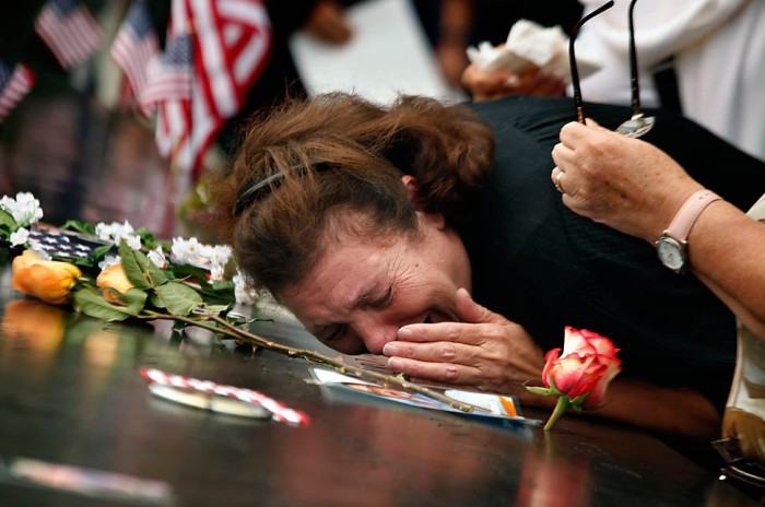 New York - A woman mourns the loss of her son at the World Trade Center Memorial during ceremonies marking the 10th anniversary of the 9/11 attacks on the World Trade Center, in New York, September 11, 2011.